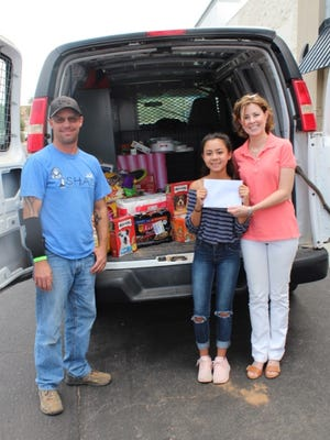 Hannah Saltman, 13, a member at Temple Beth-El synagogue, held a donation drive for Safe Haven Animal Sanctuary as part of her bat mitzvah.
