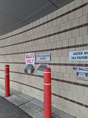 In Warren, as in many cities, there is a drive-through area outside city hall where voters can drop off their completed absentee ballots without leaving their vehicles.