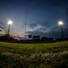 Friday night lights shine bright on the grass field in Falls City, Texas.