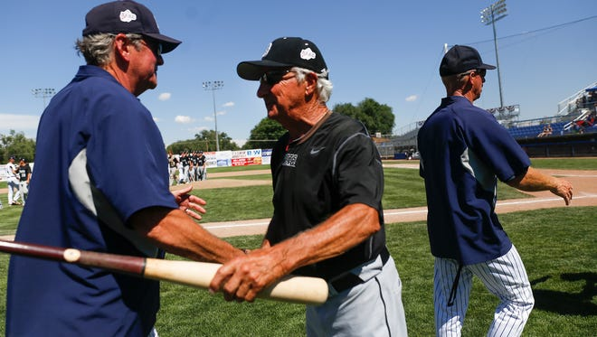 Danville Hoots head coach Don Johns, center, shakes hands with East Cobb Yankees head coach James Beavers Wednesday after Game 7 of the Connie Mack World Series at Ricketts Park in Farmington.