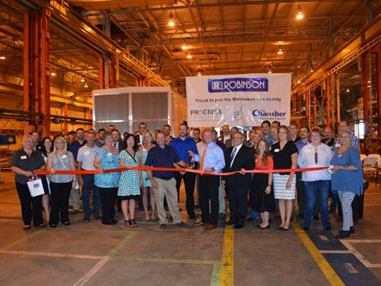 Robinson Metal in Manitowoc cuts the ribbon on its