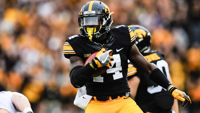 Iowa defensive back Desmond King (14) returns a punt against Northwestern during the first quarter at Kinnick Stadium on Oct. 1.