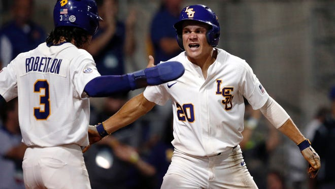LSU's Kramer Robertson (3) and Antoine Duplantis (20) celebrate after both scored on a two-run RBI double by Greg Deichmann during the eighth inning of an NCAA college baseball tournament super regional gameagainst Mississippi State in Baton Rouge, La., Saturday, June 10, 2017. LSU won 4-3. (AP Photo/Gerald Herbert)