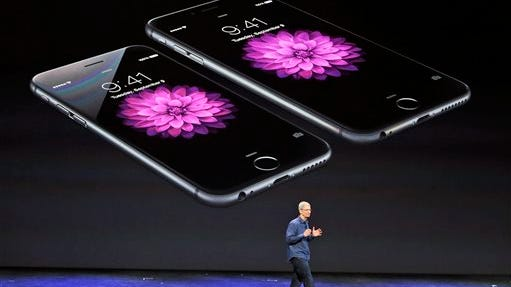 Apple CEO Tim Cook unveils the new iPhone 6 and iPhone 6 Plus.