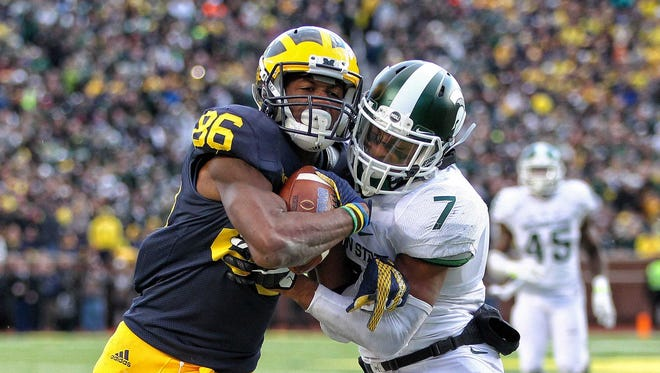 Oct 17, 2015; Ann Arbor, MI, USA; Michigan Wolverines receiver Jehu Chesson is defended by Michigan State Spartans defensive back Demetrious Cox during the 2nd half of a game at Michigan Stadium.