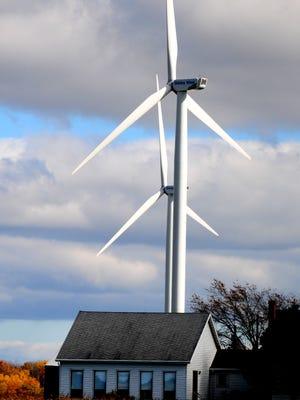 Wind turbines operate in the town of Glenmore last week.