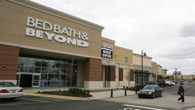 Bed Bath & Beyond  shoppers exit the store.