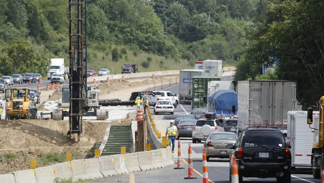 Traffic in the southbound lanes of I-65 crawls as the northbound lanes are closed Tuesday, August 4, 2015, due to emergency structural problems with the bridge over Wildcat Creek between Indiana 25 and Indiana 26. INDOT said Friday it would close another bridge over the creek, this one on Indiana 26, three miles east of I-65.