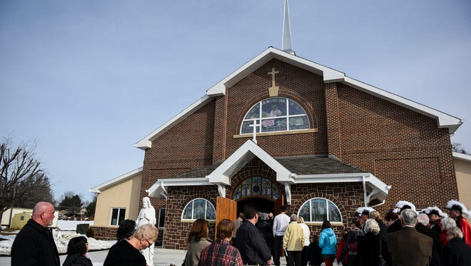 People line up to head into the new church as Sacred Heart of Jesus parish dedicated the building at  2596 Cornwall Road, Cornwall, on Sunday, Feb. 7, 2016.