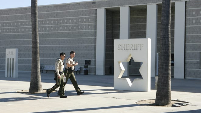 Two sheriff's deputies walk  past the Southwest Detention Center in Murrieta in 2009.  Wade Byars