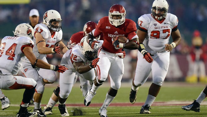 Indiana's RB Tevin Coleman,#6,, attempts to out run the tackle by Ball State's Nathan Ollie,#92, in the first half of their game Saturday evening at Memorial Stadium in Bloomington, Saturday, September 15, 2012.