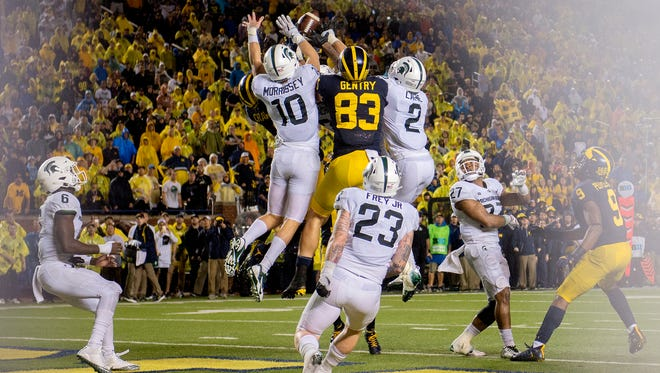 Michigan State defenders swarm a last-second Michigan pass into the end zone during the fourth quarter on Saturday, Oct. 7, 2017, at Michigan Stadium in Ann Arbor. The pass was incomplete and the Spartans won 14-10.