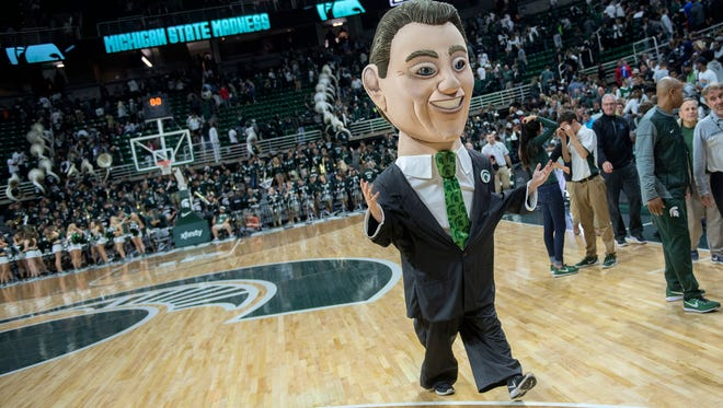 Bobble head Tom Izzo leaves the court at the end of the annual Midnight Madness event on Friday, Oct. 20, 2017, at the Breslin Center in East Lansing.