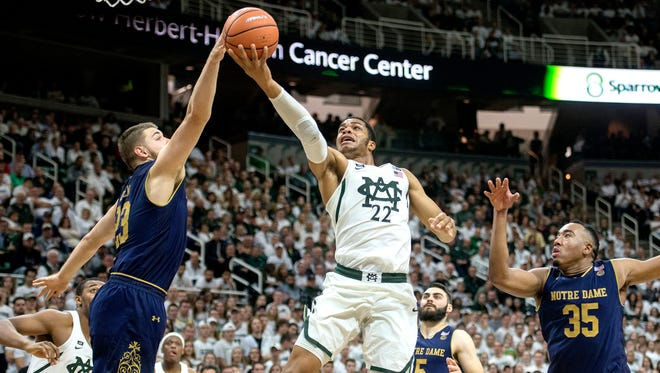 Notre Dame's during Martinas Geben, left, blocks a shot by Michigan State's Miles Bridges during the second half on Thursday, Nov. 30, 2017, at the Breslin Center. Geben's teammate Bonzie Colson, right, looks on. The Spartans beat Notre Dame 81-63.