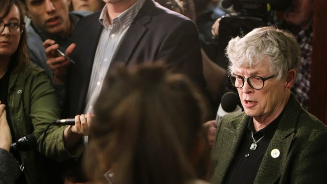 Former Michigan State University president Lou Anna Simon speaks to members of the press, victims and their families in Ingham County (Mich.) Circuit Judge Rosemarie Aquilina's courtroom during an afternoon break on Jan. 17, 2018, the second day of victim-impact statements,  regarding former sports medicine doctor Larry Nassar. Simon stepped down from her post Wednesday, Jan. 24, 2018.