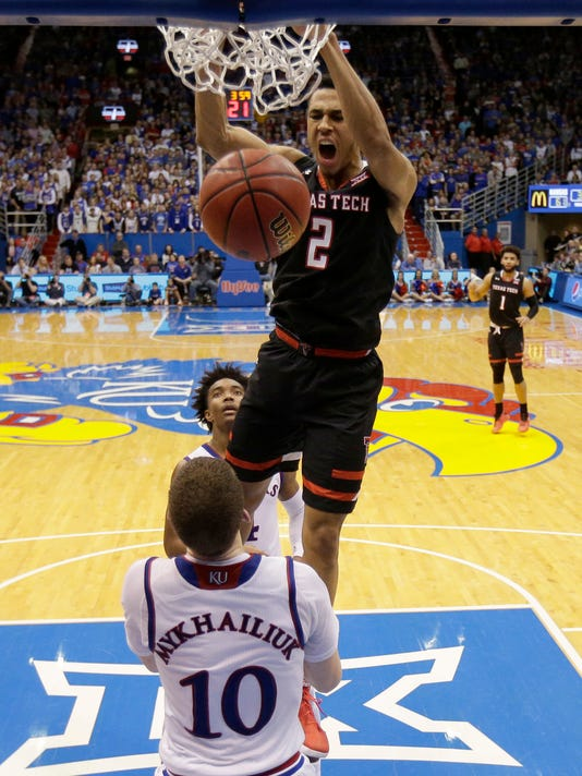 Texas Tech's Zhaire Smith (2) dunks during the second half of the team's NCAA college basketball game against Kansas on Tuesday, Jan. 2, 2018, in Lawrence, Kan. Texas Tech won 85-73. (AP Photo/Charlie Riedel)