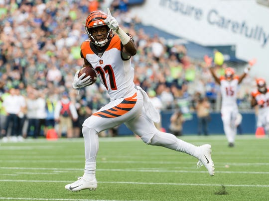 Sep 8, 2019; Seattle, WA, USA; Cincinnati Bengals wide receiver John Ross (11) catches a touchdown pass during the first half against the Seattle Seahawks at CenturyLink Field. Mandatory Credit: Troy Wayrynen-USA TODAY Sports
