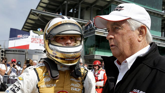 Team Penske IndyCar driver Helio Castroneves (3) talks with team owner Roger Penske,right,  following his qualifying run for the Indianapolis 500 Friday, May 20, 2017, afternoon at the Indianapolis Motor Speedway.