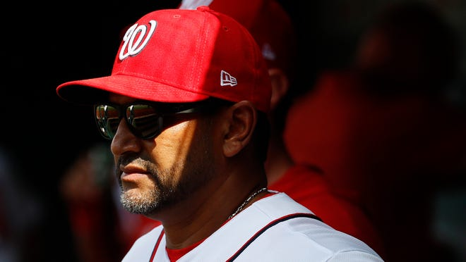 Washington Nationals manager Dave Martinez stands in the dugout in the seventh inning of a baseball game against the New York Mets, Wednesday, Sept. 4, 2019, in Washington. (AP Photo/Patrick Semansky)