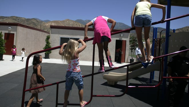 Children play during the Morongo Band of Mission Indians' dedication of the private Morongo Elementary School at the Morongo Reservation, Thursday, July 1, 2010.(Richard Lui The Desert Sun)