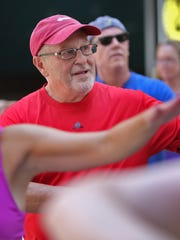 Attorney Richard Kammen, center, who is taking part in the Indy Fit Challenge, works out during the Workout Wednesday session on Georgia Street, Wednesday, June 25, 2014.  The YMCA of Greater Indianapolis runs the free weekly lunchtime workout.