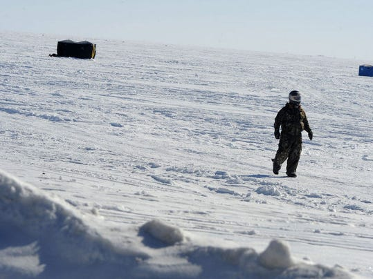 Great lakes ice cover luring polar bears it s a hoax for Ice fishing lake st clair