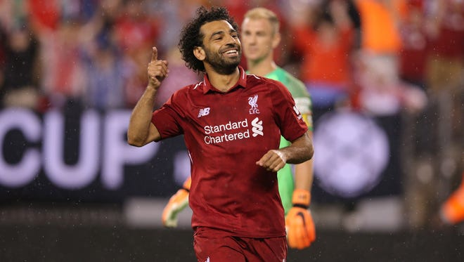 Liverpool forward Mohamed Salah celebrates his goal against Manchester City during the second half of an International Champions Cup soccer match at MetLife Stadium.