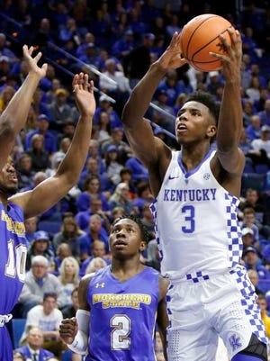 Kentucky's Hamidou Diallo (3) shoots while defended by Morehead State's Jordan Walker (2) and Alonzo Chatman (10) during the first half of an NCAA college basketball exhibition game, Monday, Oct. 30, 2017, in Lexington, Ky.