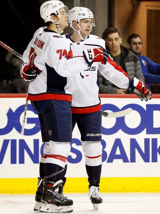 Washington Capitals center Evgeny Kuznetsov, right, celebrates with defenseman John Carlson (74), who scored against New York Islanders goaltender Jaroslav Halak during the third period of an NHL hockey game in New York, Thursday, March 15, 2018. The Capitals defeated the Islanders 7-3. (AP Photo/Kathy Willens)
