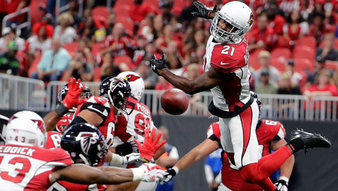 Arizona Cardinals cornerback Patrick Peterson (21) jumps for an Atlanta Falcons passed ball during the first half. Peterson dropped an interception on a ball that appeared to be thrown away.