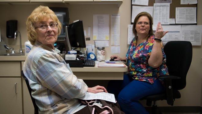 Registered Nurse Denise Morris prepares to administer a flu shot to patient Sandra McWilliams at the Knox County Health Department in Knoxville Thursday, Jan. 11, 2018.