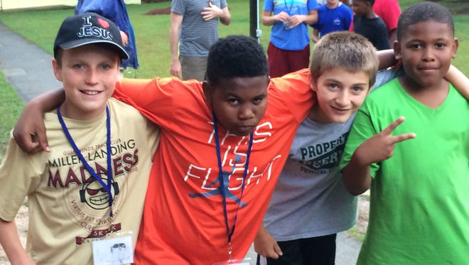 From left: Camp One participants Collin (age 12), Jalon (11), Chance (12) and Charleston (10) pose for a photo during a breakout session this week.