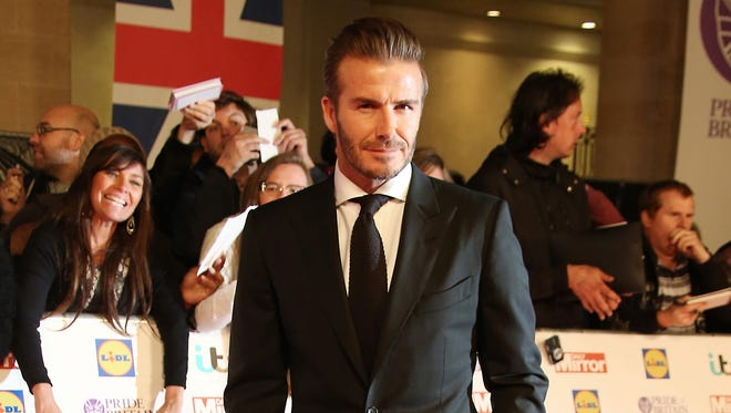 FILE - In this Monday, Sept. 28, 2015, file photo, David Beckham poses for photographers upon arrival at the Pride of Britain Awards 2015 in London.