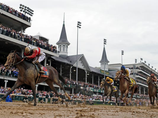 FILE - In this May 4, 2013 file photo, Joel Rosario rides Orb to victory during the 139th Kentucky Derby at Churchill Downs in Louisville, Ky. Nearly three years ago, Ogden Mills Phipps sat in his high-backed leather chair in a board room at Bessemer Trust on Fifth Avenue, smiling and delighted to talk about a dream come true: winning the Kentucky Derby with Orb. Phipps, who had been in poor health for several years, died Wednesday night, April 6, 2016, at a hospital in New York City. He was 75. He was fondly remembered by industry leaders as a great sportsman, horseman and voice of reason in trying to make racing a better, cleaner and safer sport. (AP Photo/David J. Phillip, File)