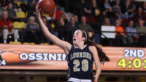 Lourdes' Madison Seigrist (20) puts up a shot during