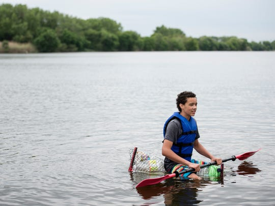 Recycle Regatta, where competitors make their watercraft out of recycled materials and then race at Overpeck County Park in Leonia on Saturday, May 20, 2017. Krstofer Collier, 13 of Hawthorne, sits on his watercraft after finishing the race and loosing parts along the way.
