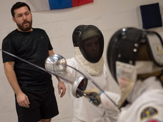 Fencing coach Robert Piraino watches his athletes as they practice for the Junior Olympics at the Music City Fencing Club Thursday, Jan. 26, 2017, in Nashville, Tenn.