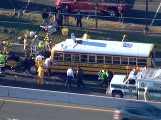 The scene of an accident on Route 35 Southbound in Middletown involving a school bus and tractor trailer is shown Friday, October 23, 2105.  IMAGE COURTESY OF NEWS12 ~
