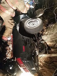 Fire crews extricated a person from a car after it