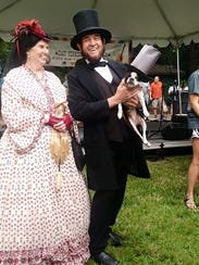 Mary Todd and Abe Lincoln, and a pup sporting a stovepipe