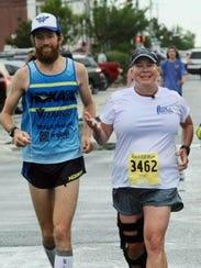 Michael Wardian runs with Sandra Waldee-Warden to the