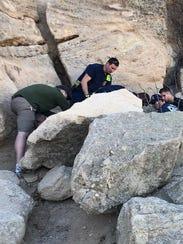 Paramedics helping Dan Smoker Sr. after his fall while