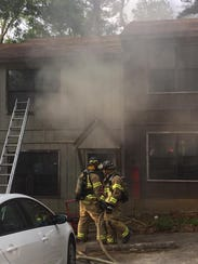 Tallahassee firefighters battle a blaze at a home on