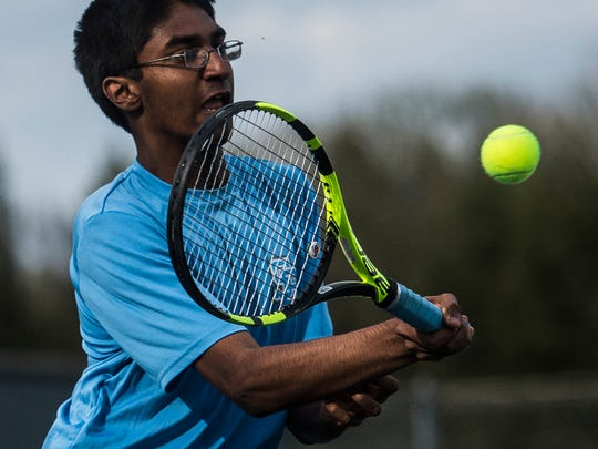 South Burlington's second seed Ragulan Sivakumar returns a shot from Essex's Andy Shen during their match up in South Burlington on Thursday, May 10, 2018.