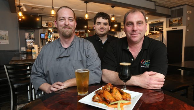 Co-owners Glenn Sayers, left and Scott Ryan, right, are pictured with their general manager Scott Grieco at 6 Degrees of Separation brewpub and restaurant on Main Street in Ossining.