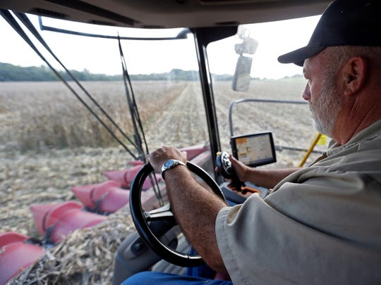 Eddie Sanders works in a cornfield Monday, Sept. 25,