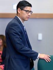 Tai Chan prepares to sit down as his trial resumed