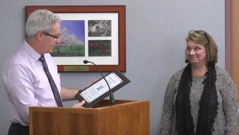Door County Human Services Director Joe Krebsbach reads a certificate of appreciation to Cyndy Zellner-Ehlers, who has retired after 35 years with the Human Service Department.