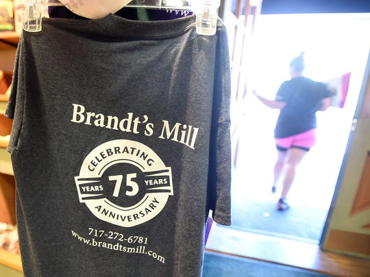 A Brandt's Mill customer leaves after purchasing dog food. Brandt's Mill is observing its 75th anniversary.