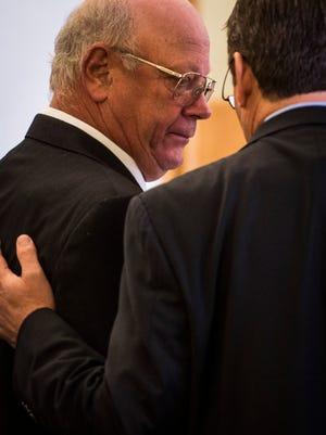 Former Republican state Sen. Norman McAllister talks with his lawyer Bob Katims in Vermont Superior Court in St. Albans on Tuesday, Oct. 17, 2017, after being sentenced. McAllister, 66, of Highgate Center was found guilty in July of setting up his female tenant to have sex with one of his acquaintances for money to pay off her electric bill.